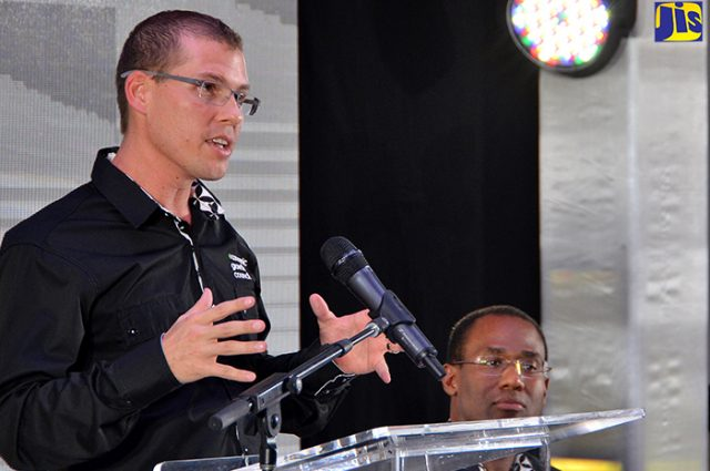 Economic Growth Council (EGC) member, Adam Stewart (left), addresses a media briefing at The Jamaica Pegasus hotel in New Kingston on Thursday, January 26. Listening is EGC Deputy Chairman, Ambassador Nigel Clarke.