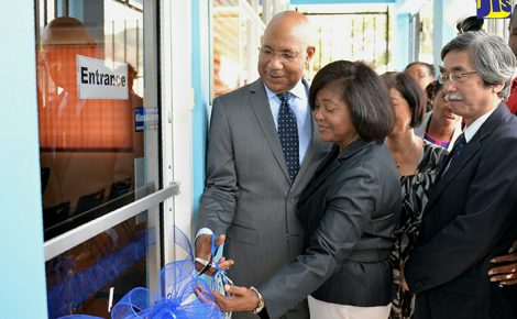 Their Excellences, the Most Hon. Governor-General, Sir Patrick Allen (left), and Lady Allen (second left), cut the ribbon to symbolise the official opening of the Jamaica Society for the Blind's (JSB) Low Vision Resource Centre at its Old Hope Road location in St. Andrew on January 26. Also pictured at right is Ambassador of Japan to Jamaica, His Excellency, Masanori Nakano.