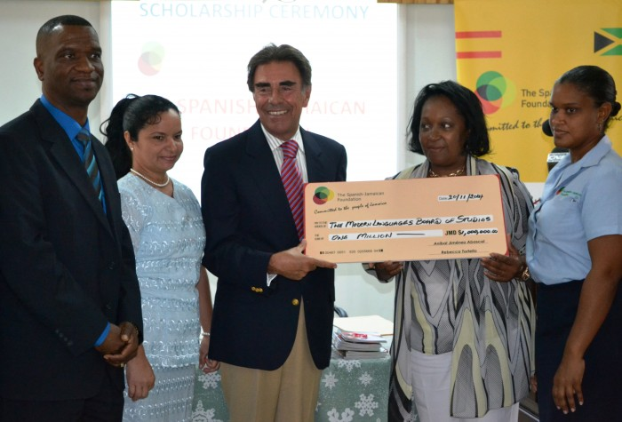 Spanish Ambassador and Spanish-Jamaican Foundation (SJF) President, His Excellency Anibal Abascal Jimenez (centre); presents a scholarship cheque for $1 million to Chairman of the Modern Languages Board of Studies, Teachers Colleges of Jamaica, Aracelis Anedu (2nd right), during a ceremony on Thursday (November 20),  at  Sam Sharpe Teachers' College in Granville, St. James. Twenty student teachers pursuing Spanish courses at Sam Sharpe, Church and Shortwood teachers colleges, will benefit from the award. Others (from left) are: Principal of Sam Sharpe Teachers' College,  Dr. Ashburn Pinnock; Language Lecturer at the college, Malbis Aranda; and SJF Project Manager, Vanessa Meggoe.