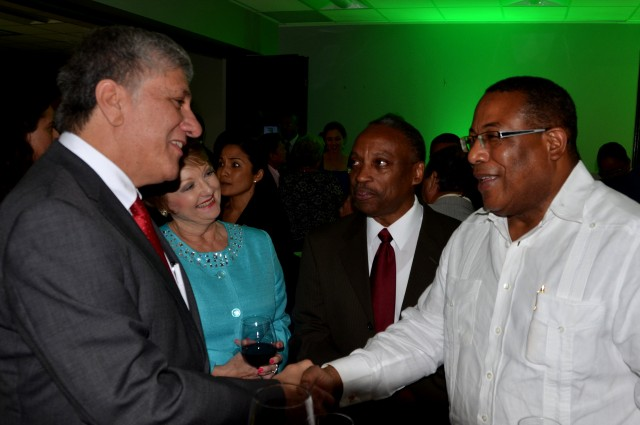Minister of Industry, Investment and Commerce, Hon. Anthony Hylton (right), is greeted by United States Ambassador to Jamaica, His Excellency Luis Moreno (left),  on his arrival at the launch of the Jamaica Investment Forum 2015 at the J. Wray and Nephew headquarters in New Kingston on Thursday (January 22).  Also pictured are: Chairman of Jamaica Promotions Corporation (JAMPRO), Milton Samuda (second right), and Executive Director, AMCHAM, Becky Stockhausen.