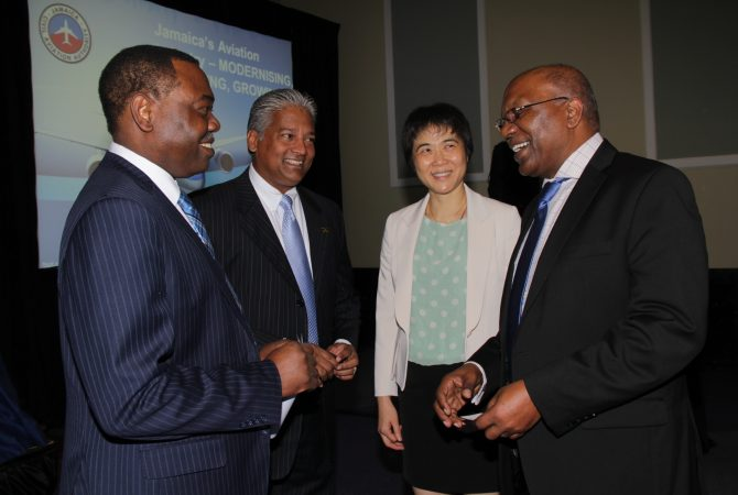 Minister without Portfolio in the Ministry of Transport, Works and Housing, Hon. Dr. Morais Guy (right), converses with (from left): President of the International Civil Aviation Organization (ICAO), Dr. Olumuyiwa Benard Aliu; Director General of the Jamaica Civil Aviation Authority (JCAA), Nari Williams-Singh; and ICAO Secretary General, Dr. Fang Liu. Occasion was the meeting of the ICAO Council at the Iberostar Hotel in Lilliput, St. James earlier this week.