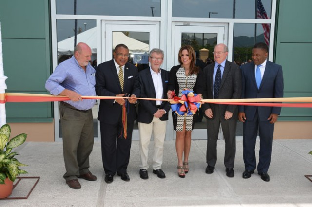 Minister of Industry, Investment and Commerce, Hon. Anthony Hylton (second left), cuts ribbon to officially open the new Barnett Tech Park in Montego Bay, on May 6. Others (from left) are: Businessman, Mark Kerr-Jarrett; President and Chief Executive Officer of ACT, Joseph Lembo; Mrs. Paula Kerr-Jarrett; Vice President Real Estate Facilities for Xerox, Tom Corne; and Minister of Science, Technology, Energy and Mining, Hon Phillip Paulwell.