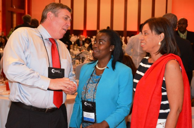State Minister for Industry, Investment, and Commerce, Hon. Sharon Ffolkes Abrahams (right); and Vice President, Operations and Customer Relations, Montego Bay Free Zone Company Limited, Gloria Henry (centre), are engaged in conversation by Digicel Jamaica's Chief Executive Officer, Barry O'Brien, during the recent two-day Jamaica Investment Forum (JIF), at the Montego Bay Convention Centre in St. James.