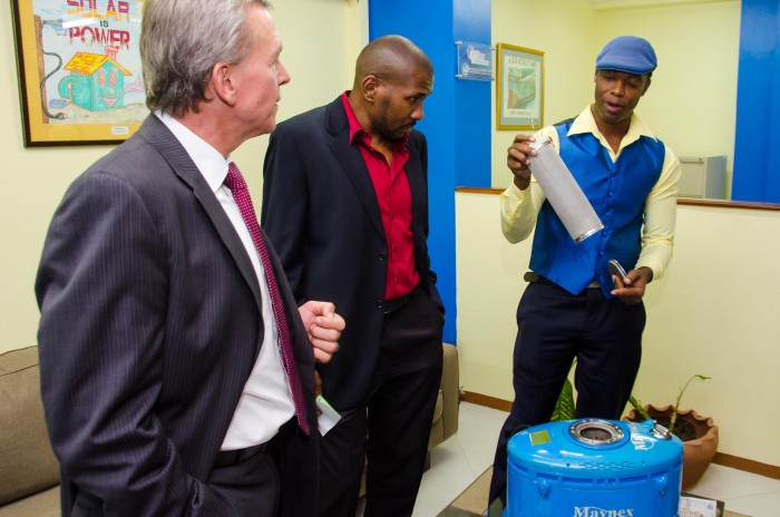 Inventor, Harlo Mayne (right), shows how his H2-Flex Hydrogen Hybrid Kit works, to (from left): Counsellor and Head, Development Cooperation at the Canadian High Commission, Walter Bernyck, and inventor, Dr. Kert Edward. Occasion was a cocktail reception to highlight the work of  the Caribbean Climate Innovation Centre,  held at the Scientific Research Council (SRC), recently.