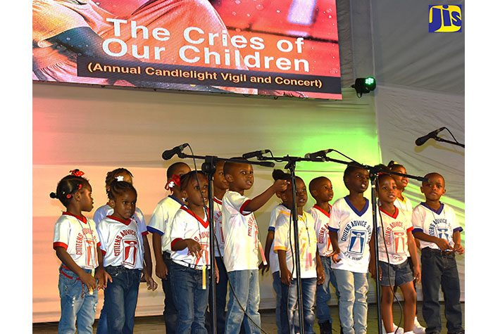 Pupils of the RJR Basic School perform during the Child Development Agency's (CDA) 11th annual candlelight vigil and concert at Emancipation Park in New Kingston on Saturday, November 19. The event is the CDA's main activity to mark World Day for the Prevention of Child Abuse, which is commemorated annually on November 19.