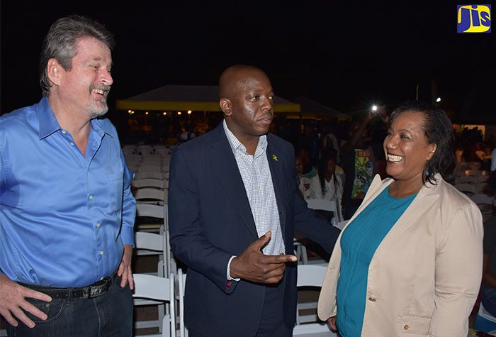 State Minister for National Security, Senator the Hon. Pearnel Charles Jr. (centre), converses with Child Development Agency (CDA) Chief Executive Officer, Rosalee Gage-Grey (right), during the CDA's 11th annual candlelight vigil and concert at Emancipation Park in New Kingston on Saturday, November 19. The event is the CDA's main activity to mark World Day for the Prevention of Child Abuse, which is commemorated annually on November 19. Looking on is United Nations Children's Fund (UNICEF) Representative in Jamaica, Mark Connolly.