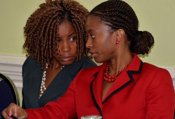 Senior Director at the Procurement Asset Policy Unit,  Ministry of Finance and Planning, Cecile Maragh (right), conversing with Advisor to Minister with responsibility for the Public Sector, Hon. Horace Dalley, Shelley-Ann Lewars, at a regional consultation forum, held recently at the Knutsford Court Hotel, in St. Andrew.