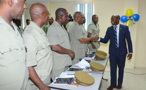 State Minister for National Security, Senator the Hon. Pearnel Charles Jr., (right), greets several of the 26 Department of Correctional Services (DCS) officers who will participate in a multinational training programme, beginning this week, in United States (US). The announcement was made during a media briefing at the DCS training office on East Street in Kingston, on Friday, September 23.