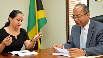 Minister without Portfolio in the Ministry of Economic Growth and Job Creation, Hon. Dr. Horace Chang (right), meets with the Organisation of American States Resident Representative, Ms. Jeanelle van Glaanen Weygel,  when she called at the Ministry's offices in Kingston on October 26.