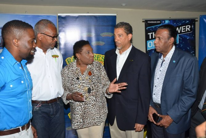 Culture, Gender, Entertainment and Sport Minister, Hon. Olivia Grange (centre) raises a point with Director of Corporate Services at Sandals Resort International, Jeremy Jones (second right), at the launch of the Sandals Under 19 Cricket Competition and Academy Programme, at Sabina Park in Kingston, on April 21. Looking on (from left) are Sponsorship & Events Manager at WISYNCO, Jermaine Brown, General Manager of Rainforest Seafoods, Jerome Miles and President of the Jamaica Cricket Association, Wilford Heaven. Cricket 2: Culture, Gender, Entertainment and Sport Minister, Hon. Olivia Grange (right) is in discussion with Director of Corporate Services at Sandals Resort International, Jeremy Jones (left) at the launch of the Sandals Under 19 Cricket Competition and Academy Programme, at Sabina Park in Kingston, on April 21. Looking on at (centre) is Jamaican Under-15 team representative, Razaq Williams.