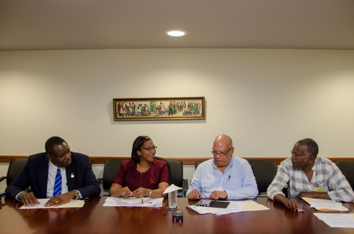 Chairman of the Labour Market Reform Commission (LMCR), Dr. Marshall Hall (second right) highlights some of the work of the group towards transforming Jamaica's labour market. Looking on from left are, Chairperson of the Education and Training Subcommittee, Dr. Wayne Wesley, Chairperson of the Social Protection Subcommittee, Dr. Heather Ricketts and Deputy Chairman of the LMRC and Chairperson of the Productivity, Technology and Innovation Committee, Silburn Clarke (right) during a recent interview with JIS News at the Planning Institute of Jamaica