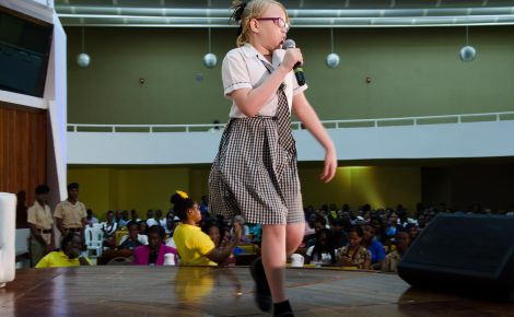 Young Tahalia Mitchell performs a dub poetry piece during today's (June 19) staging of the Unite For Change National Forum on Youth Violence Prevention at the Jamaica Conference Centre in downtown Kingston.