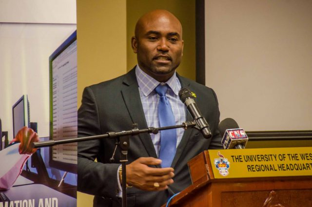 Science, Energy and Technology Minister, Dr. the Hon. Andrew Wheatley, addressing the Jamaica Computer Society's (JCS) symposium, which was held at the University of the West Indies' Regional Headquarters in Mona, St. Andrew, on Friday, June 9, under the theme: 'The Future of IT Jobs'.