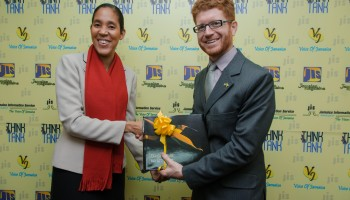 Donna-Marie Rowe, Chief Executive Officer of the Jamaica Information Service (JIS) presents a gift to Mr. Joshua W. Polacheck, new Counselor for Public Affairs at the United States Embassy in Kingston.  Mr. Polacheck paid a courtesy call on the CEO on Friday December 19.