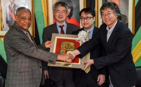 Minister of Labour and Social Security, Hon. Derrick Kellier (left), presents a gift to Japanese Embassy representative, Hiromoto Oyama (right), during a courtesy call at the Ministry's North Street offices on Thursday (June 18), by members of the Japanese Funds Special Monitoring Mission. Others from (2nd left) are: Principal Technical Lead and Inter-American Development Bank (IDB) Representative, Japan, Kazushige Taniguchi; and Deputy Director, Ministry of Finance, Japan, Nobuyuki Imamura