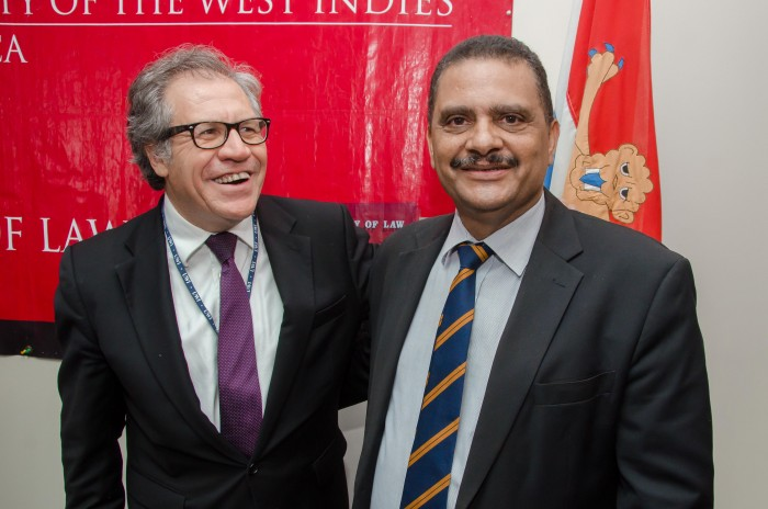 Secretary General of the Organization of the American States (OAS), H.E Luis Almargo (left), and Dean of the Faculty of Law, University of the West Indies, Mona, Dr. Derick McKoy, share a moment following the official launch of a collaboration between the OAS and the UWI Department of Government for a Programme on Citizenship Education on Monday, November 2, at the Faculty of Law.
