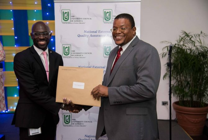 Chairman of the Accreditation, Curriculum and Development Committee, University Council of Jamaica (UCJ), Dr. Lowell Dilworth (left), presents President of the College of Agriculture, Science and Education (CASE), Dr. Derrick Deslandes, with certificates of accreditation for several of the programmes offered at the institution. The presentation was made during the 30th anniversary awards luncheon of the UCJ at the Spanish Court Hotel in New Kingston on October 27. During the event, certificates of registration and accreditation were issued to recently registered institutions and those with programmes that have been accredited or re-accredited during the period March 2016 to September 2017.