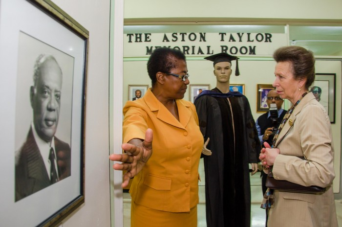 Her Royal Highness, the Princess Royal (right), is shown a portrait of the late former Governor-General, and distinguished Mico University College graduate, His Excellency, the Most Hon. Sir Howard Cooke, on display in the institution's Museum, in Kingston, by Curator, Hyacinth Birch, during her visit on Thursday, October 1. The visit formed part of the Princess Royal's three-day working visit to Jamaica, from September 30 to October 2, for the Caribbean-Canada Emerging Leaders Dialogue (CCELD), among other engagements.