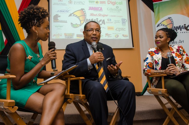 Minister of Industry, Investment and Commerce, Hon. Anthony Hylton  (centre), is interviewed by hosts, Cherine Anderson (left) and Debbie Bissoon,  at the launch of the inaugural Jamaica Film Festival, held on June 10 at Jamaica Promotions Corporation (JAMPRO), in New Kingston.