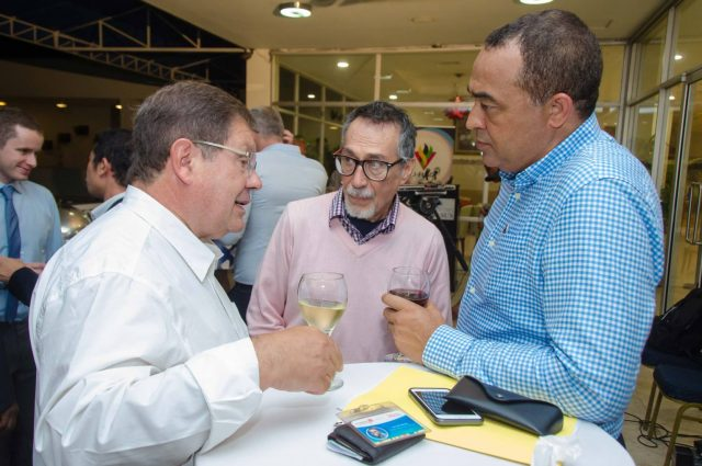 Health Minister, Dr. the Hon. Christopher Tufton (right) engages in discussion with Vice-President of External Affairs for ViiV Healthcare, Dr. Manuel Goncalves (left) at a reception at The Jamaica Pegasus hotel in New Kingston on August 30. At (centre) is Chairperson of Viiv Healthcare's Positive Action Programme, Juan Jacobo Hernández.