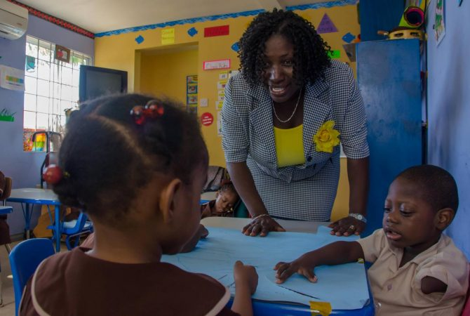 Director of the Early Stimulation Programme (ESP), Mrs. Antonica Gunter-Gayle, interacts with young children enrolled in the programme, at the Stimulation Plus (STIM-PLUS) Child Development Centre, in Kingston.