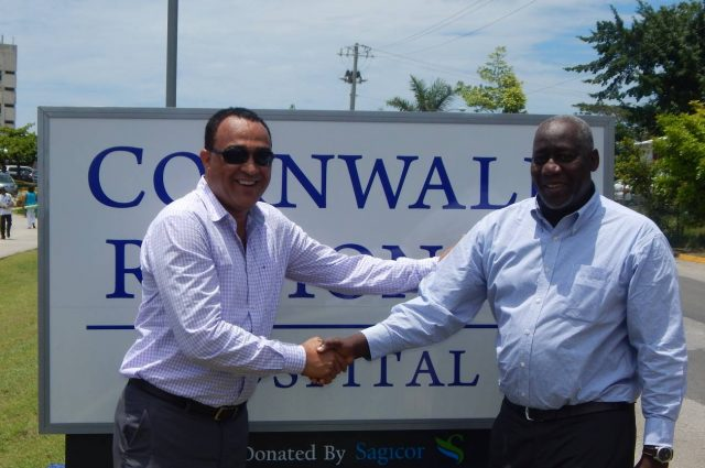 Minister of Health, Dr. Christopher Tufton (L) and Mr. Rohan Miller (R), President & CEO, Sagicor Investments share a light moment during the Sagicor Sigma Corporate Run presentation ceremony held on June 23, 2016, at the Cornwall Regional Hospital board room. JA$16 million worth of equipment and medical supplies was officially handed over to the Cornwall Regional Hospital from the proceeds from the 2015 Sigma Corporate Run. Sagicor also donated directional and welcome signs to the hospital.