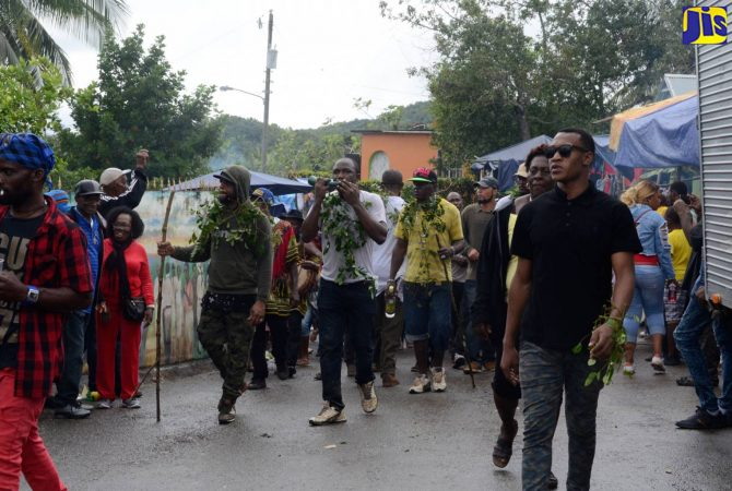 Maroons of Accompong Town lead a procession to the official opening ceremony to mark the 280th anniversary of the signing of the Peace Treaty between the Accompong Town Maroons and the British, in Accompong Town, St. Elizabeth, on January 6.
