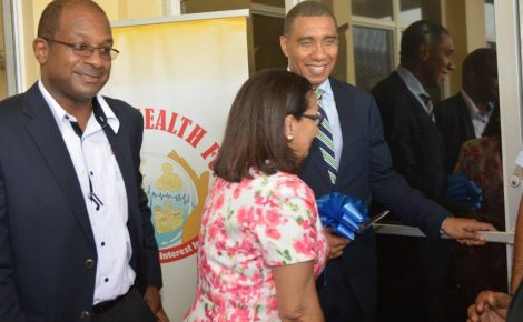 Prime Minister, the Most Hon. Andrew Holness (third left), cuts ribbon to open the renovated male surgical ward at the St. Ann's Bay Regional Hospital in St. Ann, on October 6. Others (from left) are: Senior Vice President, Information and Communications Technology, National Health Fund, Granville Gayle and Minister of Labour and Social Security, Hon. Shahine Robinson.