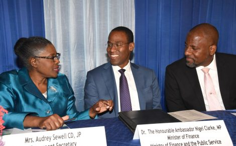 Finance and Public Service Minister, Dr. the Hon. Nigel Clarke (centre), and Planning Institute of Jamaica (PIOJ) Director General, Dr. Wayne Henry (right), converse with Permanent Secretary in the Ministry of Economic Growth and Job Creation, Audrey Sewell, during the 10th PIOJ/Inter-American Development Bank Labour Market Forum, which was held recently at the Terra Nova Hotel, St. Andrew.