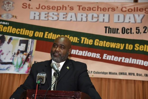 Senior Advisor in the Ministry of Science, Energy and Technology, Trevor Forrest, addresses St. Joseph's Teachers' College's Research Day on the grounds of the institution in St. Andrew on Thursday (October 5).