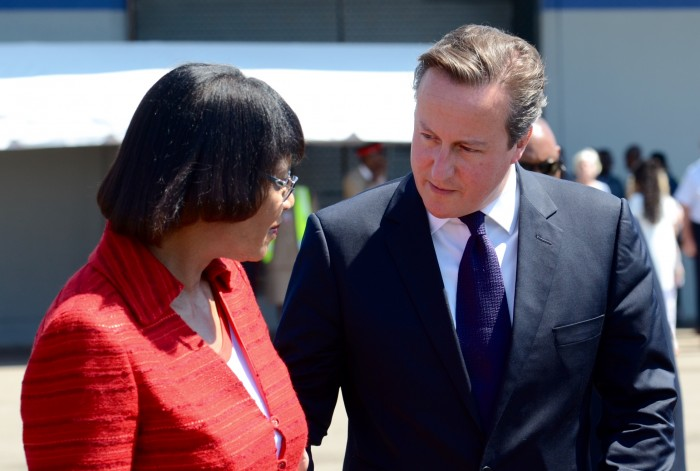 Prime Minister, the Most Hon. Portia Simpson Miller, is in discussion with the United Kingdom (UK) Prime Minister, the Right Hon. David Cameron, as he prepares to depart the island from the Norman Manley International Airport on September 30, after a one day official visit.