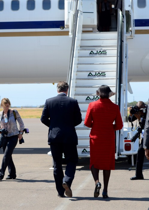 United Kingdom (UK) Prime Minister, the Right Hon. David Cameron, is escorted to his plane at the Norman Manley International Airport by Prime Minister, the Most Hon. Portia Simpson Miller. Mr. Cameron departed the island today (September 30), after a one day official visit, where he had bilateral talks with Mrs. Simpson Miller; addressed a joint sitting of Parliament; and participated in a wreath laying ceremony at the cenotaph for World War soldiers at National Heroes Park.