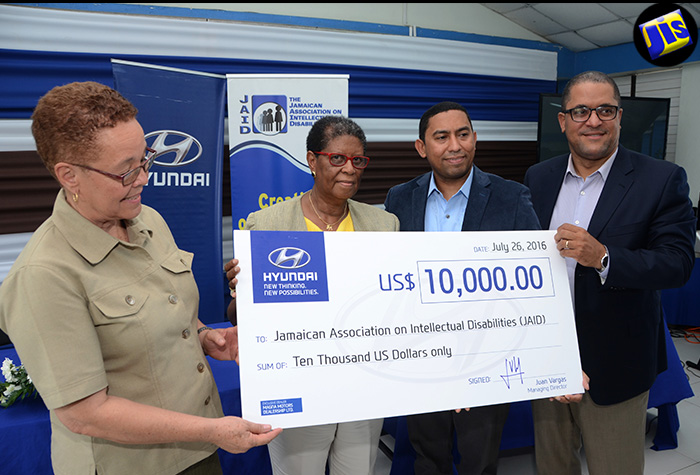 From left: Acting Executive Director, Jamaica Association on Intellectual Disabilities (JAID), Christine Rodriguez; President of JAID, Sonia Jackson; After-sales Manager, Elis Jimenez; and Supply Chain Director, Erick Gutierrez, hold the US$10,000 cheque donated to the special needs institution towards the installation of a state-of-the-art wheelchair lift. The cheque presentation ceremony was held on July 26 at JAID's 7 Golding Avenue address in St. Andrew.