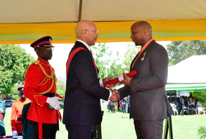 Governor General, His Excellency, the Most Hon. Patrick Allen, presents the Badge of Honour for Gallantry to Dr. Ricard Bennett, at the 2015 National Honours and Awards Ceremony at King's House today (October 19). Dr. Bennett was honoured for his bravery in saving the life of a neighbour, who had been badly wounded, even after getting into a motor vehicle accident while taking the injured man to the hospital.