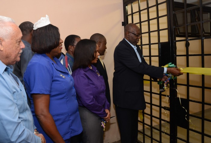 Minister of Health, Hon. Dr. Fenton Ferguson (right), cuts the ribbon to officially open the expanded Accident and Emergency (A&E) Department at the May Pen Hospital in Clarendon on (November 21).. Others (from left to right) are: Member of Parliament for Central Clarendon, Mike Henry; Director of Nursing at the hospital, Yvonne Brown-Smite; Chief Executive Officer at the hospital, Nadia Nunes; and Senior Medical Officer, Dr. Bradley Edwards.