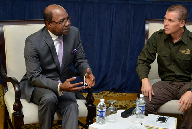 Minister of Tourism, Hon. Edmund Bartlett (left), in discussion with Sandals International Resorts CEO, Adam Stewart, at the inaugural Island Routes Caribbean Adventures Certified Partners Conference at the Sandals Ochi Beach Resort in Ocho Rios, St. Ann, on September 14.