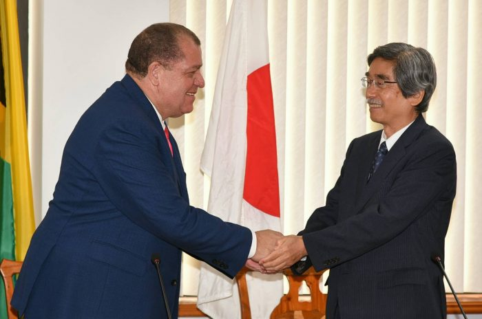 Finance and the Public Service Minister, Hon. Audley Shaw (left), greets Japanese Ambassador to Jamaica, His Excellency Masanori Nakano, at the signing ceremony for the Exchange of Notes and the Record of Discussions, at the Minister's Heroes Circle offices in Kingston, on October 6.