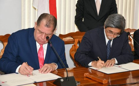 Finance and the Public Service Minister, Hon. Audley Shaw (left), and Japanese Ambassador to Jamaica, His Excellency Masanori Nakano, sign the Record of Discussions and Exchange of Notes at the Minister's Heroes Circle offices in Kingston on October 6.
