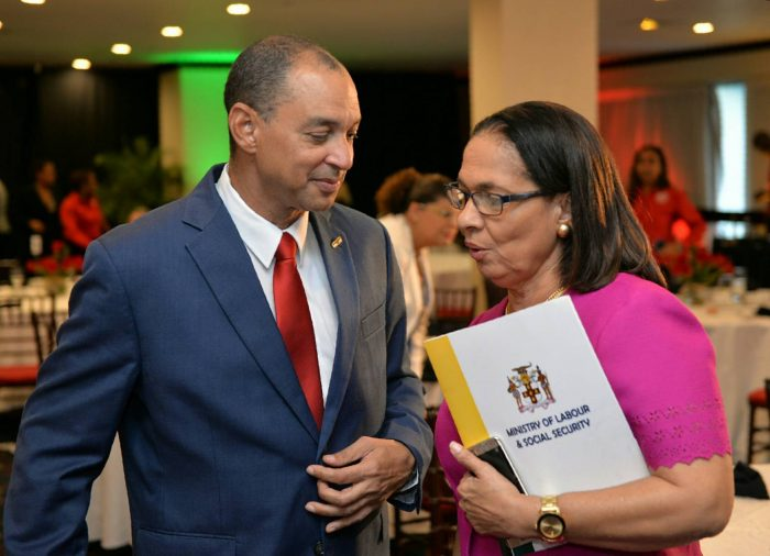 Minister of Labour and Social Security, Hon. Shahine Robinson (right), speaking with Group Chief Executive Officer for GraceKennedy Limited, Senator Don Wehby, at the GraceKennedy/Heather Little-White Household Worker of the Year Awards Presentation Ceremony, held on October 5 at The Jamaica Pegasus hotel in Kingston.
