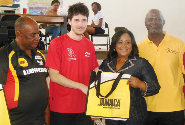 Minister without portfolio with responsibility for Sports in the Office of the Prime Minister, Hon. Natalie Neita Headley (2nd right), makes a presentation to Damion Provost of France (2nd left), the number one seeded male player at the Jamaica Winter Table Tennis Championships. Occasion was the closing day of the two-day tournament held on March 1, and the Montego Bay Community College's auditorium in St. James. Sharing the moment are President of the Jamaica Table Tennis Association (JTTA), Godfrey Lothian (left); and General Manager of the Sports Development Foundation (SDF), Denzil Wilks.