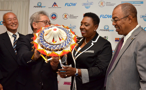 Minister of Culture, Gender, Entertainment and Sport, Hon. Olivia Grange (2nd right), receives a gift from Chairman of the Tottori Athletic Association in Japan, Shinichi Hamasaki (2nd left), at the press launch for the Jamaica International Invitational (JII) Track and Field Meet held at the Jamaica Pegasus Hotel in New Kingston on May 5. Sharing the moment (from left) are: Managing Director for the Japan Association for Athletics Federation (JAAF), Akihiko Nitta; and Jamaica Athletics Administrative Association (JAAA) President, Dr. Warren Blake. The one day meet will be held on May 7 at the National Stadium in Kingston.