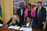 Minister of Culture, Gender, Entertainment and Sport, Hon. Olivia Grange (seated right), and Director and Representative of the United Nations Educational, Scientific and Cultural Organization's (UNESCO) Cluster Office for the Caribbean, Katherine Grigsby, prepare to sign the US$ 60,000 funding agreement for the revision of the National Culture Policy. The support is being provided by UNESCO's International Fund for Cultural Diversity (IFCD). Observing (from left, standing) are: Secretary General, Jamaica National Commission for UNESCO, Everton Hannam; Principal Director of Culture in the Ministry, Dr. Janice Lindsay; and Cultural Programme Specialist, UNESCO Cluster Office, Yuri Peshkov. The signing ceremony was held on May 5, at the Ministry's head office in Kingston.