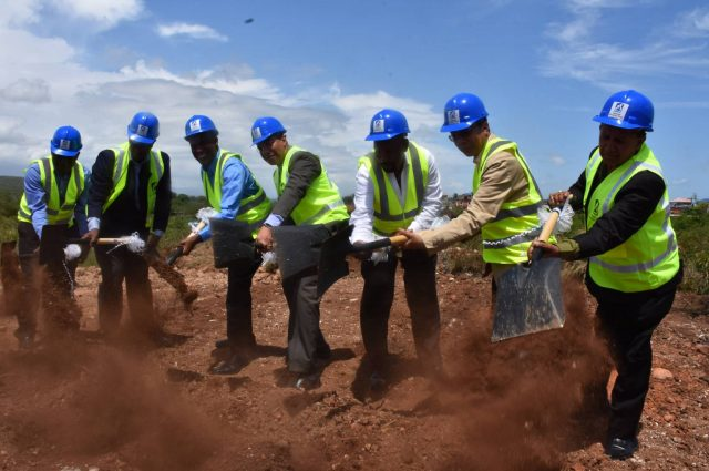 Prime Minister, the Most Hon. Andrew Holness (centre), breaks ground for 85 housing solutions in Phase 2A of the Longville Park Housing Development in Clarendon on April 28. Others (from left) are: Longville Park Citizens' Association President, Baldwin McKenzie; Managing Director of the National Housing Trust (NHT) Martin Miller; NHT Chairman, Ambassador, Dr. Nigel Clarke; Member of Parliament for Clarendon South East, Hon. Rudyard Spencer; Minister without Portfolio in the Ministry of Economic Growth and Job Creation, Hon. Dr. Horace Chang and National Security Minister, Hon. Robert Montague.