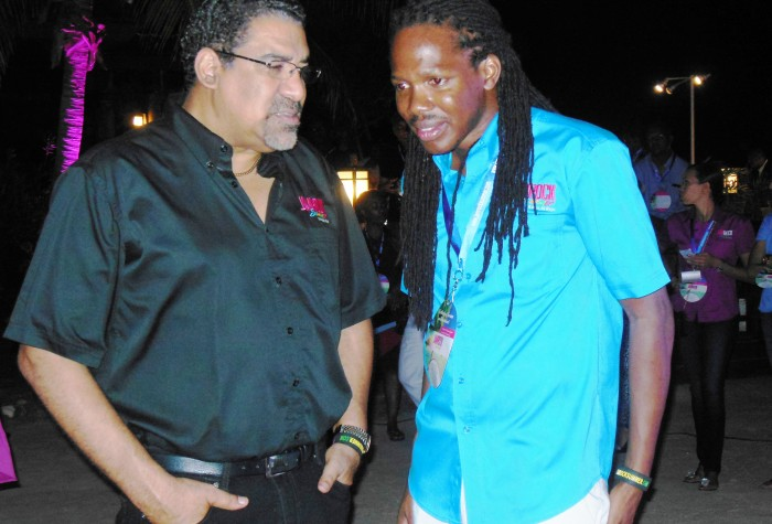Tourism and Entertainment Minister, Hon. Dr. Wykeham McNeill  (left), in discussion with his  Minister of State, Hon. Damion Crawford, at a recent function in Montego Bay. Dr. McNeill said things are looking very positive for the upcoming Winter Tourist season, which runs from December 15, 2014 to April 15, 2015.