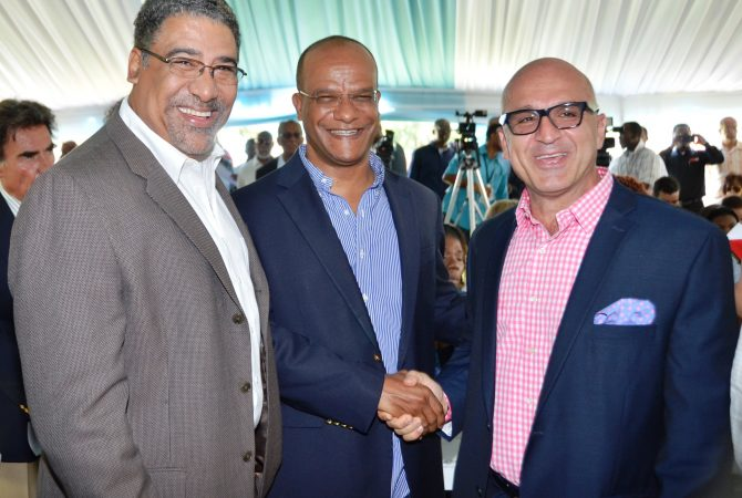 Tourism and Entertainment Minister, Hon. Dr. Wykeham McNeill (left) is all smiles as he joins National Security Minister, Hon. Peter Bunting (centre) in greeting the General Manager of the Melia Braco Village in Trelawny, Mr. Dimitris Kosvogiannia at the launch of the Spanish-based resort in Jamaica on Friday April 24. The property which is owned by the National Insurance Fund, has been leased to Melia Resorts for 15 years.