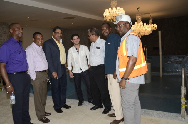 Tourism and Entertainment Minister, Hon. Dr. Wykeham McNeill (3rd left), is joined by Director of Tourism, Mr. Paul Pennicooke (2ndleft)  and Chairman of the Jamaica Tourist Board, Mr. Dennis Morrison (3rd right), at  one of Moon Palace's Spa Pools during a tour of the resort in Ocho Rios, St. Ann, on June 18.  The rehabilitated hotel is slated for a soft opening in July. Others (from left) are: Vice President, Investments and Promotions at Jamaica Promotions Corporation (JAMPRO), Claude Duncan; Vice President of Playa Resorts Management, the Parent company of Moon Palace, Gibran Chapur (centre); General Manager of the hotel, Clifton Reader and a representative of  contractors.
