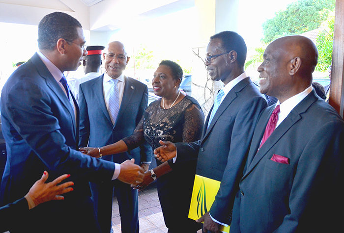 Prime Minister, the Most Hon. Andrew Holness (left) greets Minister of Culture, Gender, Entertainment and Sport, Hon. Olivia Grange (third left) on his arrival at the Andrew's Memorial Seventh-day Adventist Church, 29 Hope Road. The occasion was the National Heritage Week Thanksgiving Church Service held today (October 8) at the church. Observing from second left are Governor General His Excellency the Most Hon. Sir Patrick Allen, Chairman of the Committee for the Promotion of National Religious Services, Pastor Adrian Cotterell and Pastor of the Andrew's Memorial Seventh-day Adventist Church, Leonard Steele.