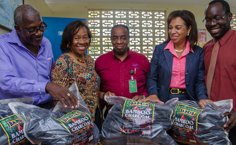 "Industry, Investment, and Commerce State Minister, Hon. Sharon Ffolkes-Abrahams (2nd right), views 'BAMJA' brand organic bamboo charcoal produced at the Institute of Nursing, Technology, and Household Management (INTHM), Swallowfield Road, Kingston, utilising the ""Gentle Bamboo Charcoal Kiln', which was assembled at INTHM. Others (from left) are: the kiln's designer, INTHM Director, and engineer, Gentle Wallace; Principal, INTHM, Tressie Wallace; Director, Special Projects, Bureau of Standards Jamaica (BSJ) and Chairman, Bamboo and Indigenous Materials Committee (BIMAC), Gladstone Rose; and INTHM's Administrator, André Tait."