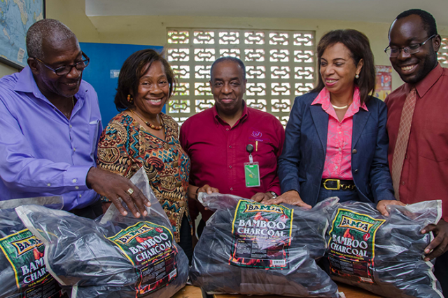"""Industry, Investment, and Commerce State Minister, Hon. Sharon Ffolkes-Abrahams (2nd right), views 'BAMJA' brand organic bamboo charcoal produced at the Institute of Nursing, Technology, and Household Management (INTHM), Swallowfield Road, Kingston, utilising the """"Gentle Bamboo Charcoal Kiln', which was assembled at INTHM. Others (from left) are: the kiln's designer, INTHM Director, and engineer, Gentle Wallace; Principal, INTHM, Tressie Wallace; Director, Special Projects, Bureau of Standards Jamaica (BSJ) and Chairman, Bamboo and Indigenous Materials Committee (BIMAC), Gladstone Rose; and INTHM's Administrator, André Tait."""