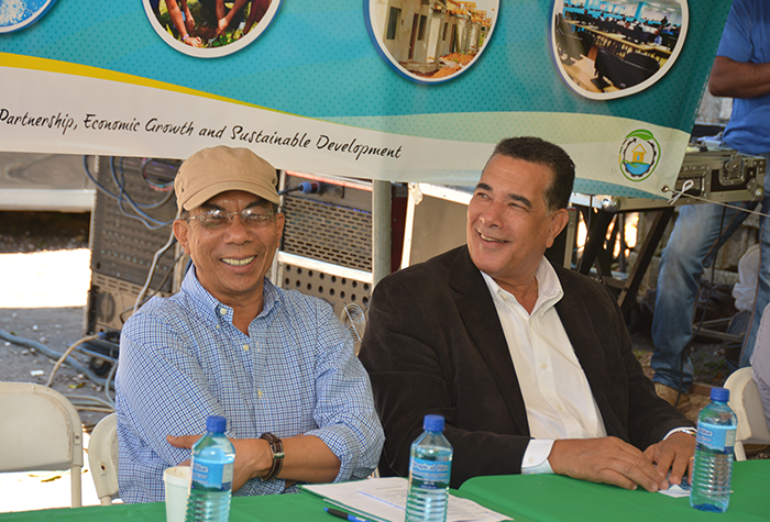 Minister without Portfolio in the Ministry of Economic Growth and Job Creation, Hon. Dr. Horace Chang (left), shares a joke with Montego Bay Mayor, Councillor Homer Davis, during the commissioning of the Warsop/John Daggy water supply system in Trelawny on February 10.